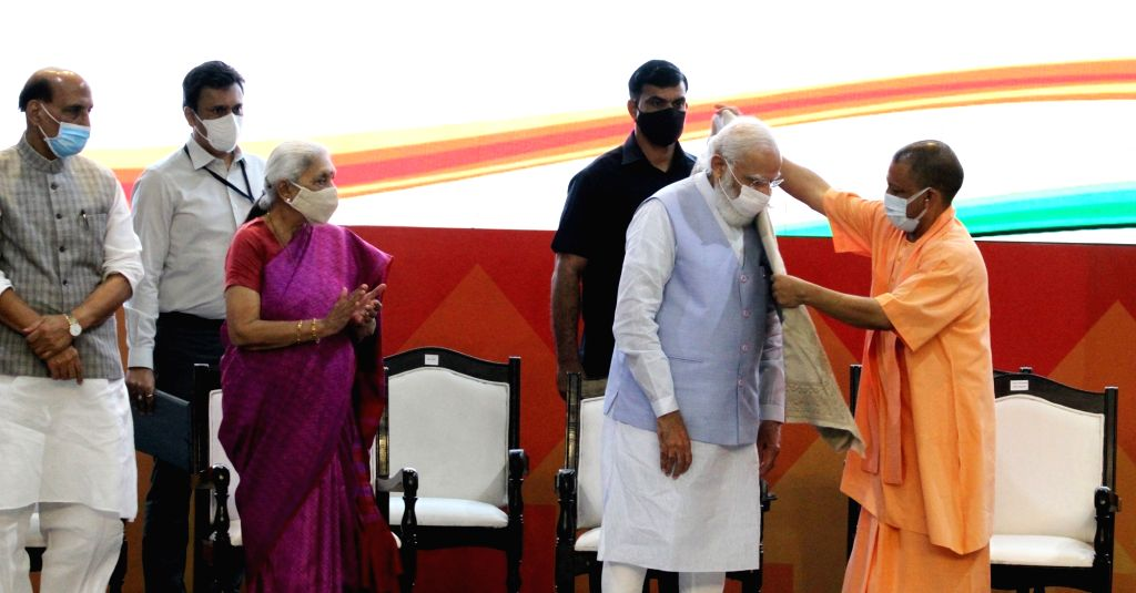 Prime Minister Narendra Modi with UP Chief Minister Yogi Adityanath and and Governor Anandiben Patel during Transforming Urban Landscape conference cum Expo in Lucknow in Tuesday October 05,2021, ... - Narendra Modi and Anandiben Patel