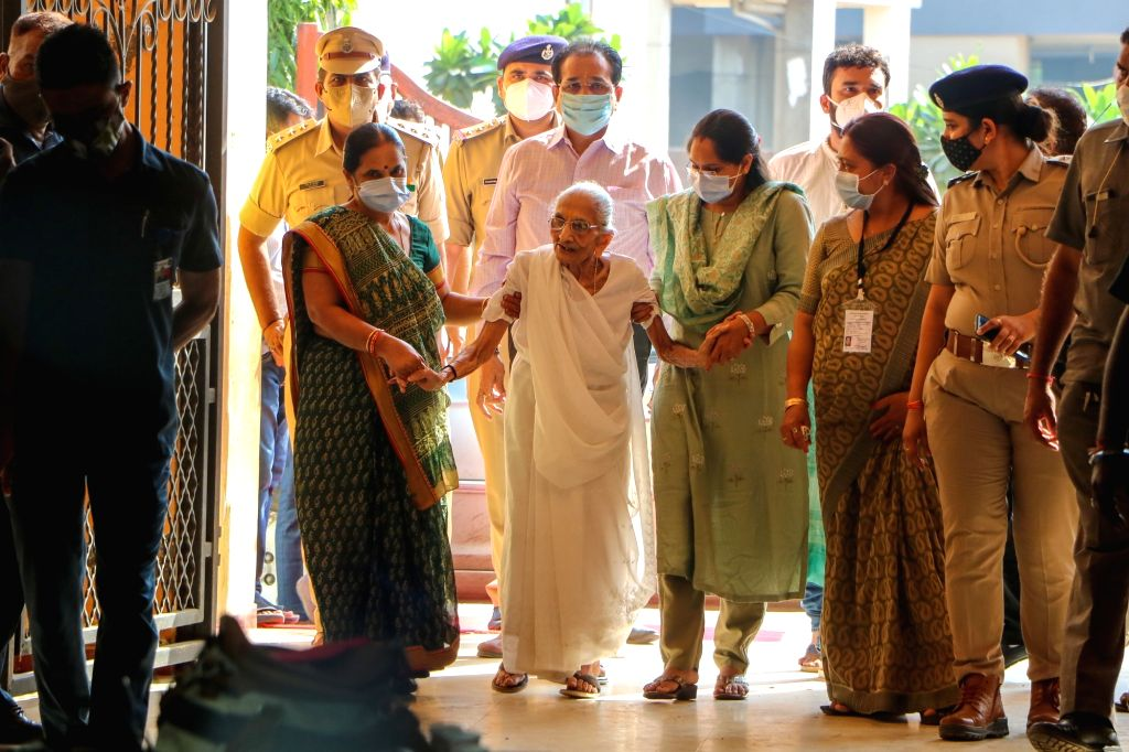 Prime Minister Narendra Modis mother Heeraben Modi arrive at a polling centre to cast her vote during Gandhinagar Municipal corporation Elections at Gandhinagar on Sunday,October 03,2021 - Narendra Modis and Heeraben Modi