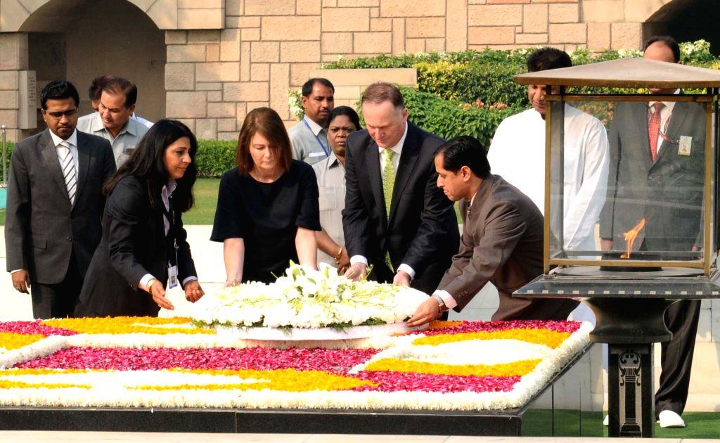 Prime Minister of New Zealand John Key laying wreath at the Samadhi of Mahatma Gandhi, at Rajghat, in Delhi on October 26, 2016.