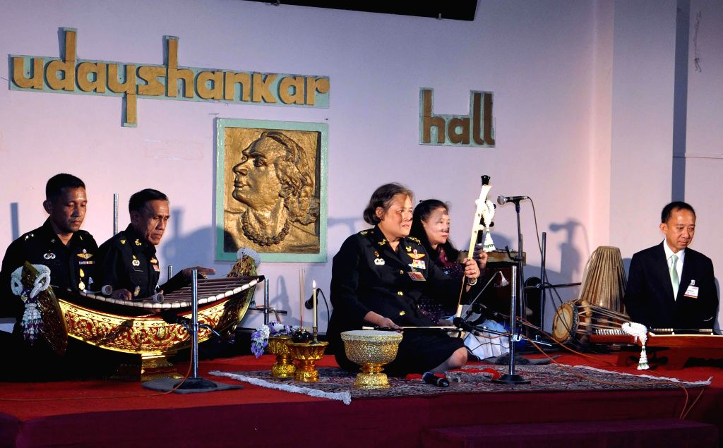 Princess of Thailand Maha Chakri Sirindhorn plays an instrument during her visit to  Jorasanko Thakur Bari in Kolkata on July 22, 2014.