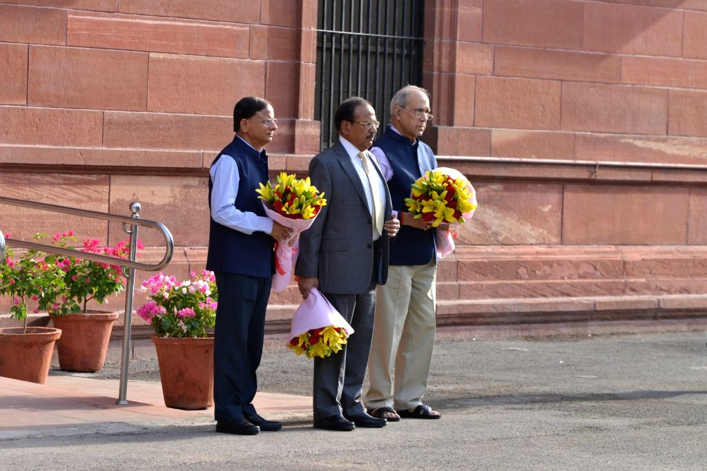 Principal Secretary to the Prime Minister, Nripendra Misra, National Security Adviser Ajit Doval and the Additional Principal Secretary to the Prime Minister P.K. Mishra as they wait for ... - P., Narendra Modi and K. Mishra