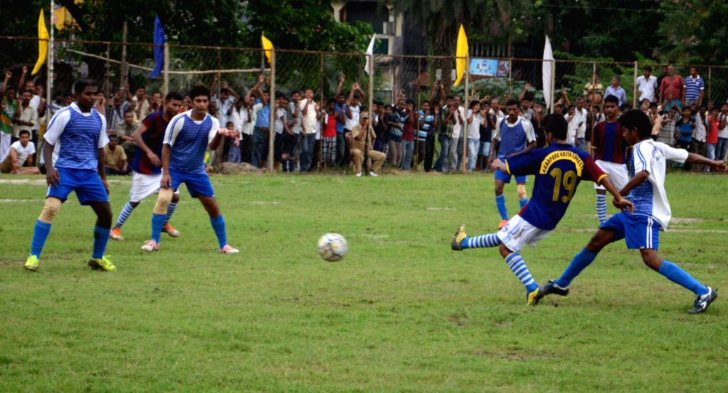 Prisoners during a football match in Agarpara of West Bengal's North 24 Parganas on Aug 25, 2014.