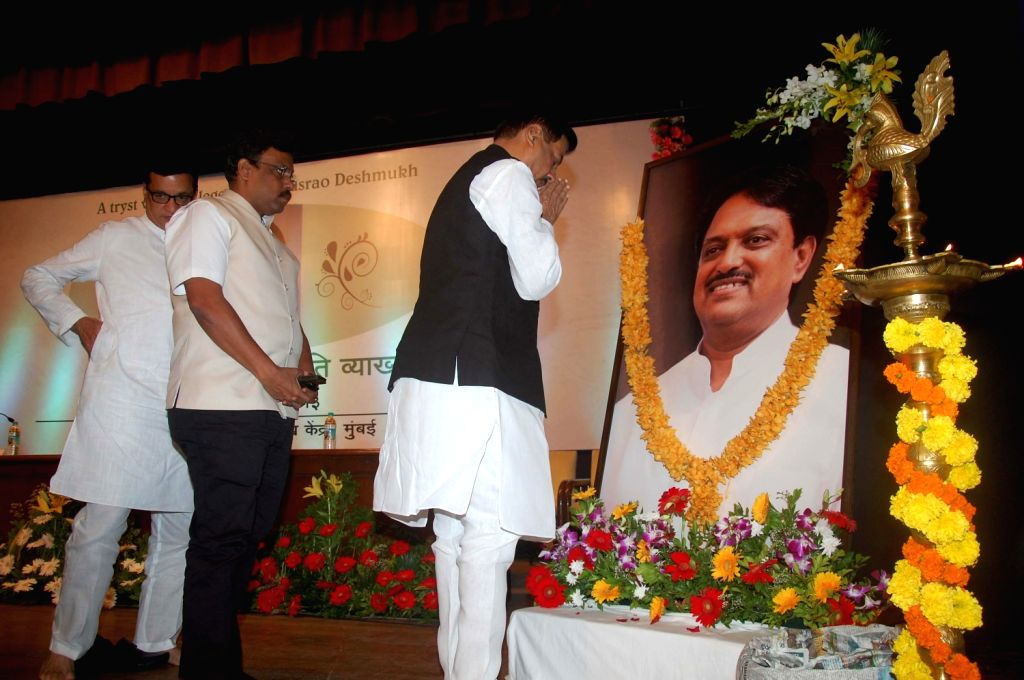 Prithivraj Chavan, Chief Minister of Maharashtra pay tribute to Late Union Minister Vilasrao Deshmukh on his 1st death anniversary in Mumbai on August 14, 2013. (Photo:::Sandeep Mahankal/IANS)