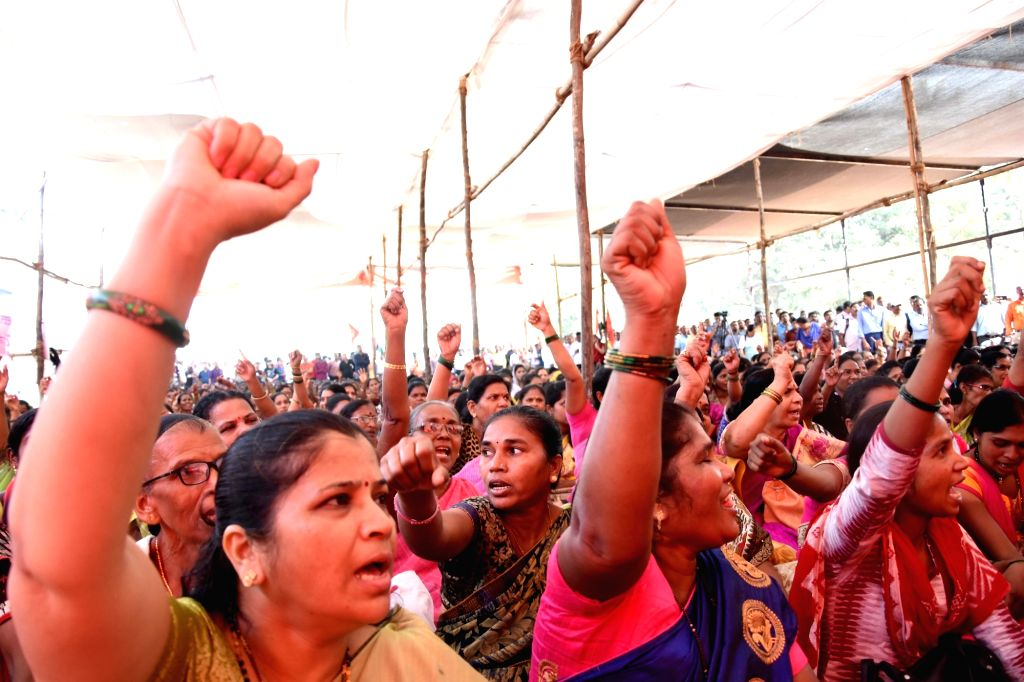 Private sector and Government employees stage a demonstration to press for their various demands during a nationwide strike called by central trade unions against central government's ...