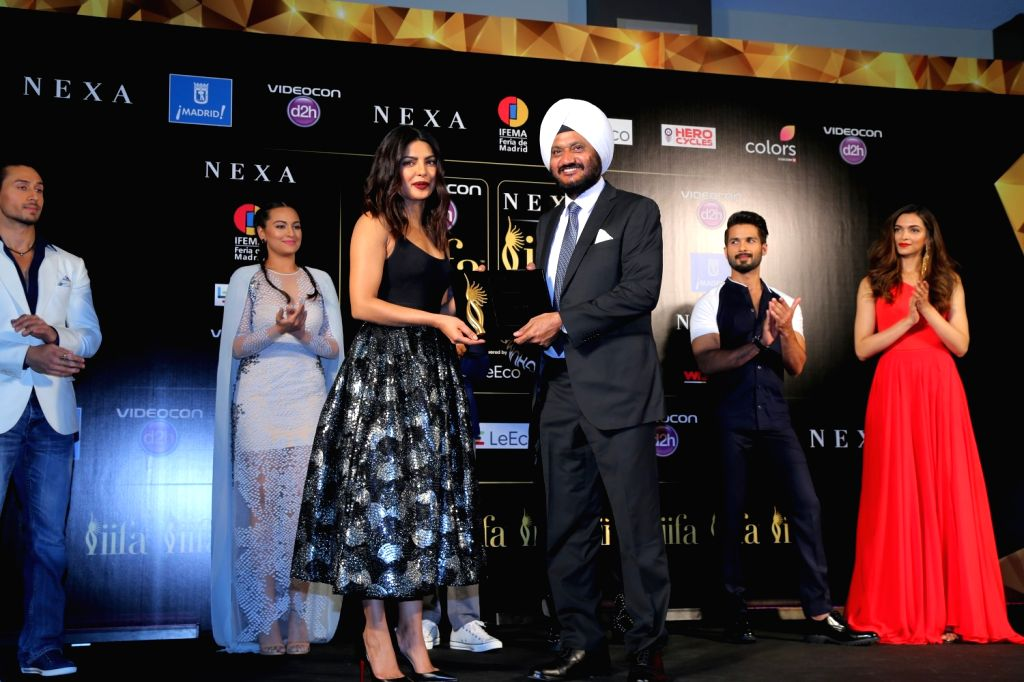 Priyanka Chopra with R S Kalsi during the IIFA 2016 opening press conference in Madrid on June 23, 2016. - Priyanka Chopra