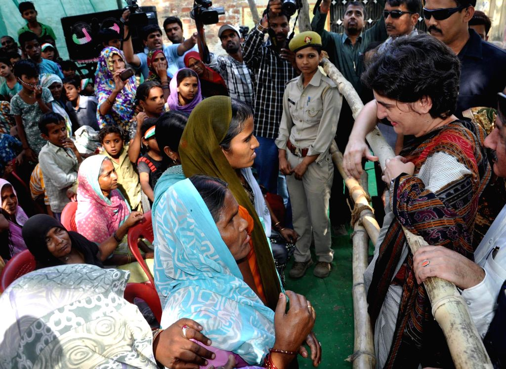 Priyanka Gandhi interacts with people during an election campaign for her mother and Congress chief Sonia Gandhi in Rae Bareli on April 22, 2014.