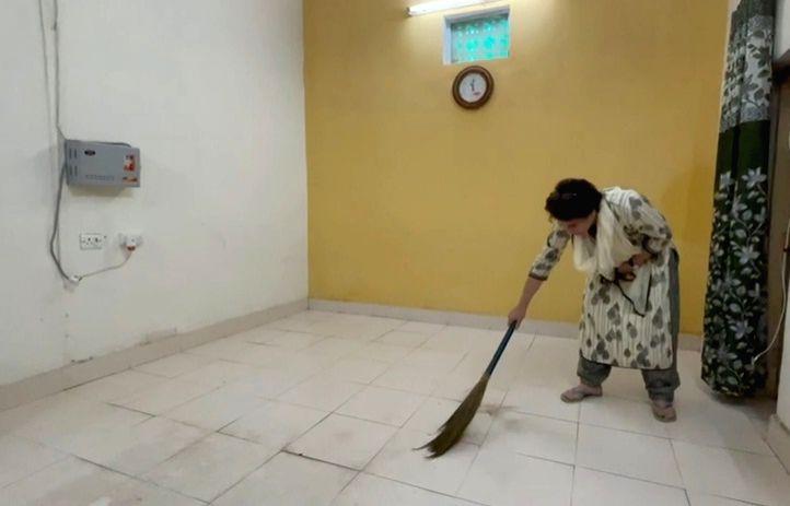 Priyanka sweeps her room in detention