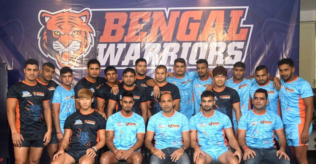 Pro Kabaddi team Bengal Warriors coach KK Jagadeesha Kumble with players during a press conference to launch Bengal Warriors' new jersey in Kolkata on July 25, 2017.