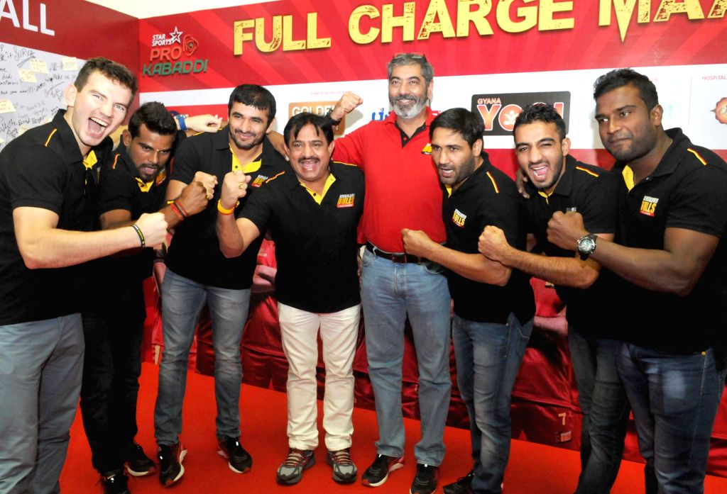 Pro-kabaddi team Bengaluru Bulls owner Uday Sihn Wala, coach Randhir Singh and players during a programme in Bengaluru, on Aug 11, 2015. - Randhir Singh