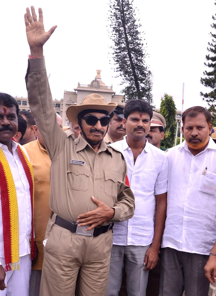 Pro-Kannada activist Vatal Nagaraj dressed up as a policeman, stages a demonstration demanding implementation of Raghavendra Auradkar committee report on police reforms, in front of Vidhan ...
