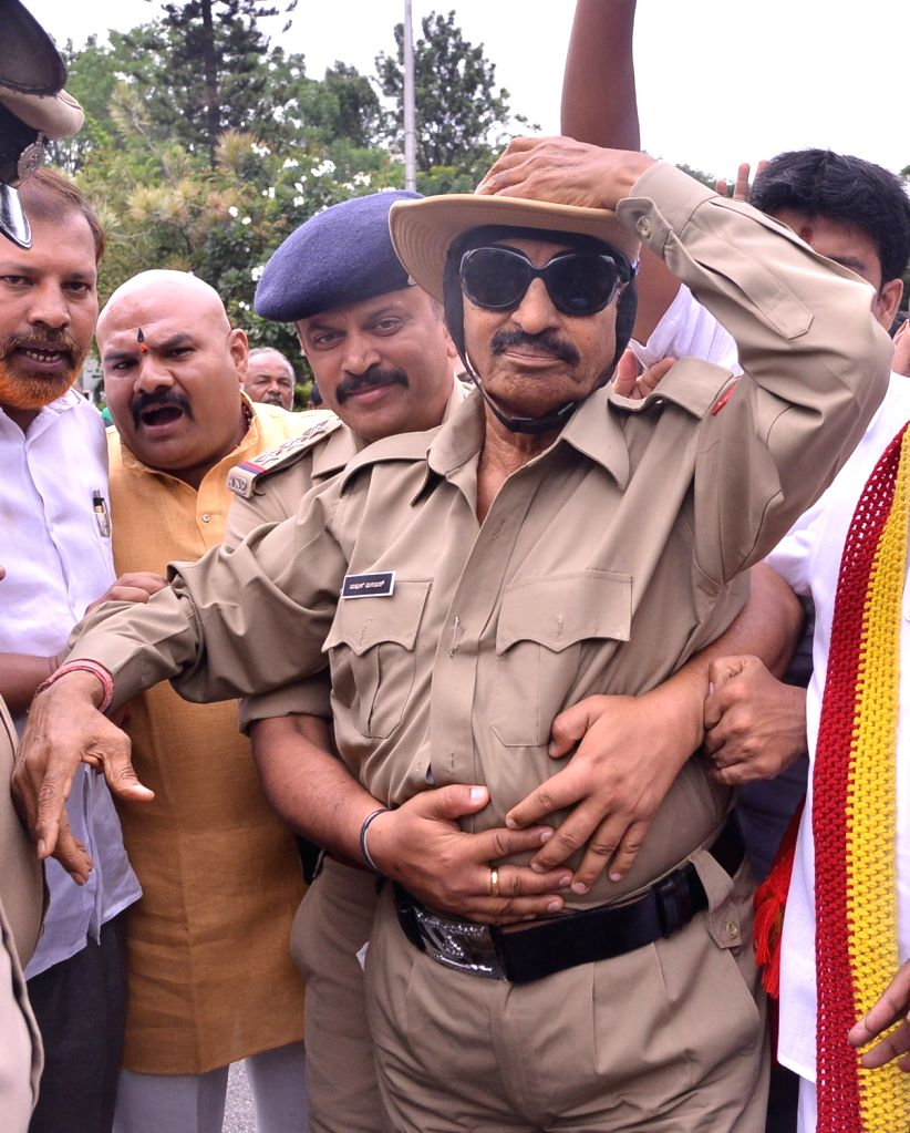 Pro-Kannada activist Vatal Nagaraj who dressed up as a policeman and staged a demonstration demanding implementation of Raghavendra Auradkar committee report on police reforms, being taken ...