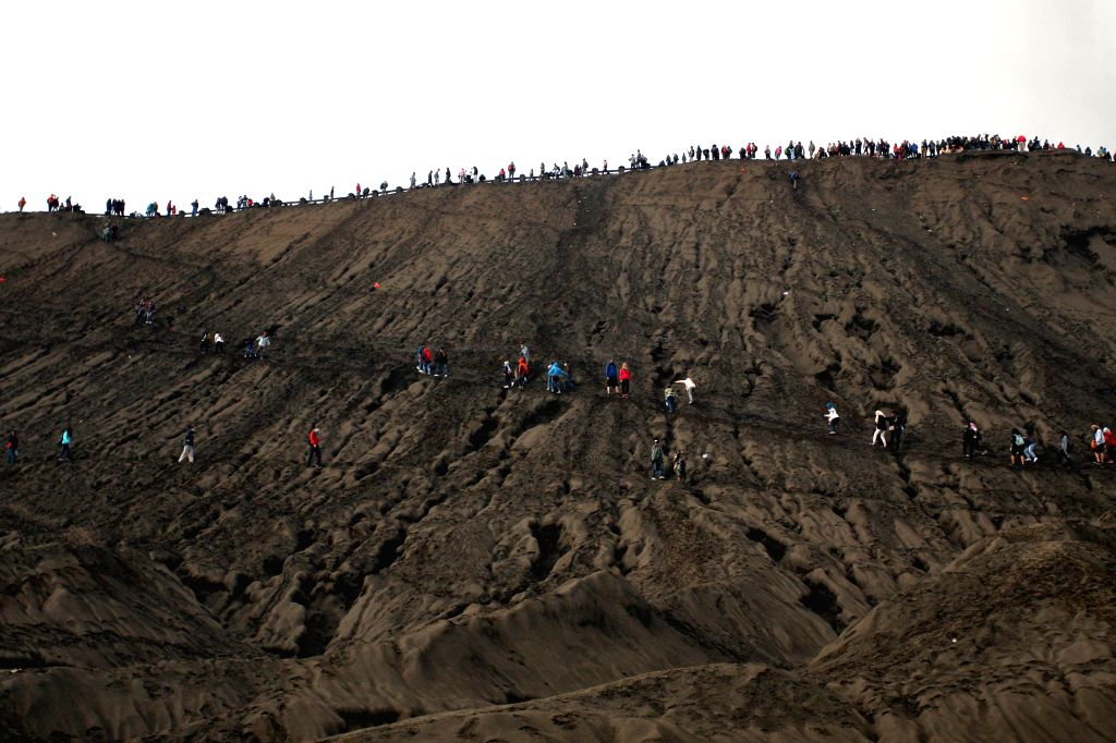 PROBOLINGGO, July 21, 2016 - People hike to watch offerings thrown in Mount Bromo at the traditional Kasada festival in Probolinggo, East Java, Indonesia, July 21, 2016. Hindu worshipers gave ...
