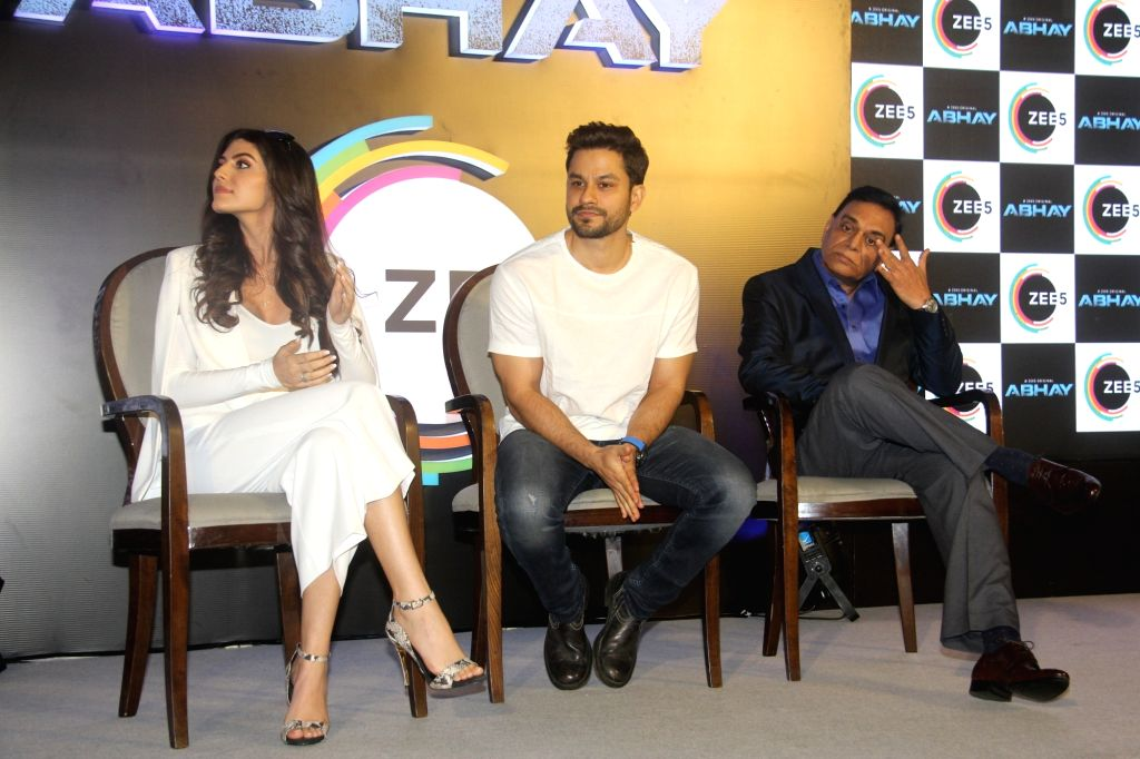 "Producer B.P. Singh with actors Kunal Khemu and Elnaaz Norouzi at the launch of their upcoming web series ""Abhay"" in Mumbai, on Feb 4, 2019. - Kunal Khemu, Elnaaz Norouzi and P. Singh"
