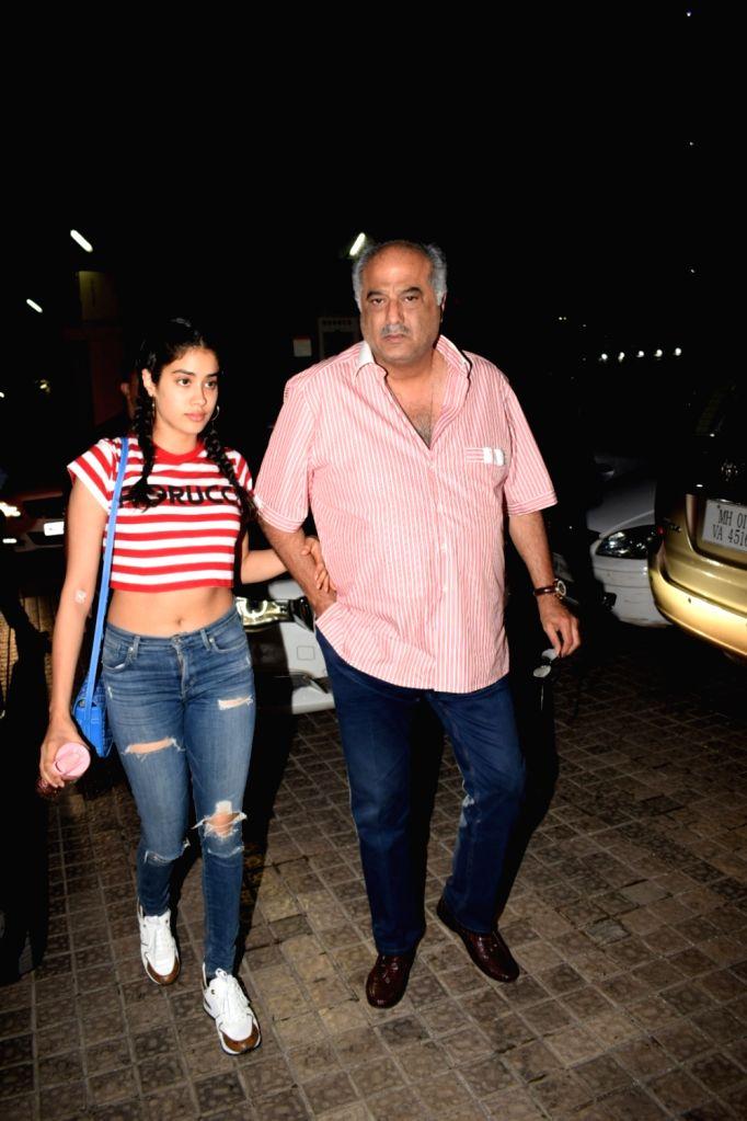 Producer Boney Kapoor along with his daughter Janhvi Kapoor seen at cinema theater in Mumbai's Juhu on May 20, 2018. - Boney Kapoor and Janhvi Kapoor