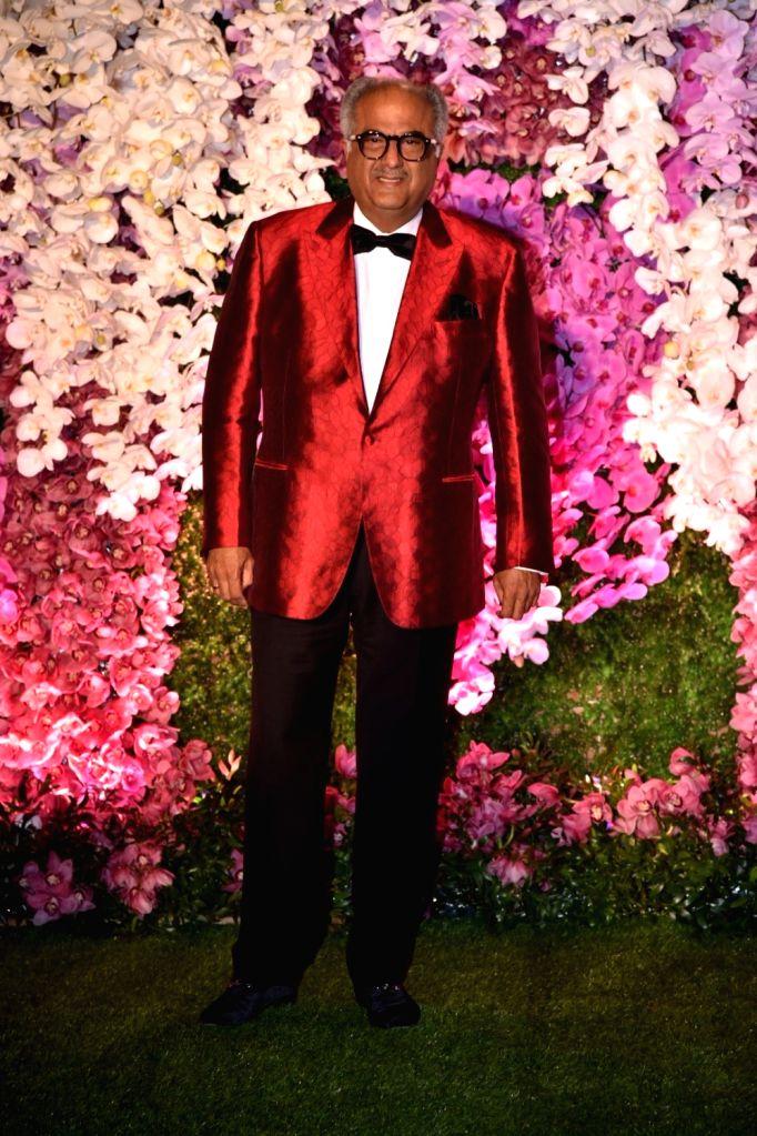 Producer Boney Kapoor at the wedding reception of Akash Ambani and Shloka Mehta in Mumbai on March 10, 2019. - Boney Kapoor, Akash Ambani and Shloka Mehta