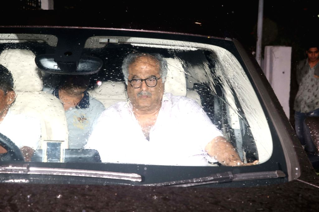 Producer Boney Kapoor reaches the residence of actor Shashi Kapoor in Mumbai on Dec 5, 2017. Veteran actor Shashi Kapoor passed away at a city hospital here on Dec 4  after a period of ... - Shashi Kapoor and Boney Kapoor