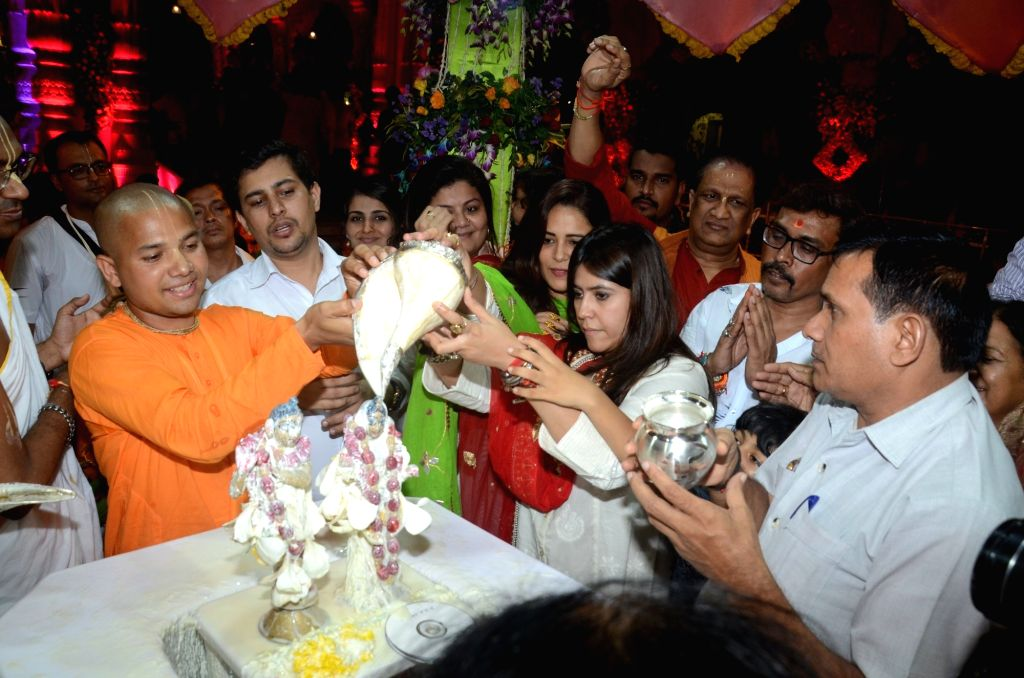 Producer Ekta Kapoor performs 'Krishna Abhishek' (bathing Lord Krishna's idol) during Janmashtami celebrations at ISKCON temple, in Mumbai on Sept 3, 2018. - Ekta Kapoor