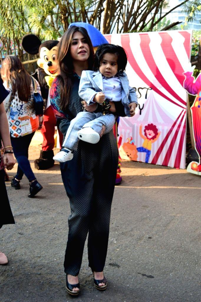 Producer Ekta Kapoor with her son Ravie Kapoor at his first birthday party in Mumbai on Jan 26, 2020. - Ekta Kapoor and Ravie Kapoor