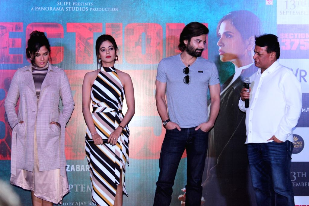 "Producer Kumar Mangat with actors Richa Chadha, Meera Chopra and Rahul Bhat at the trailer launch of their upcoming film ""Section 375"" in Mumbai on Aug 13, 2019. - Richa Chadha, Meera Chopra, Rahul Bhat and Kumar Mangat"