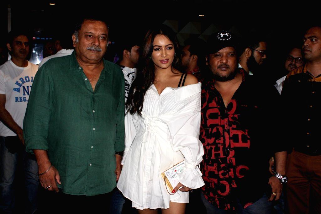 "Producer Ravinder Jeet Dariya and director Rajiv S. Ruia with actress Pooja Bisht at the special screening of their upcoming ""Mushkil"" in Mumbai on Aug 8, 2019. - Rajiv S. Ruia"