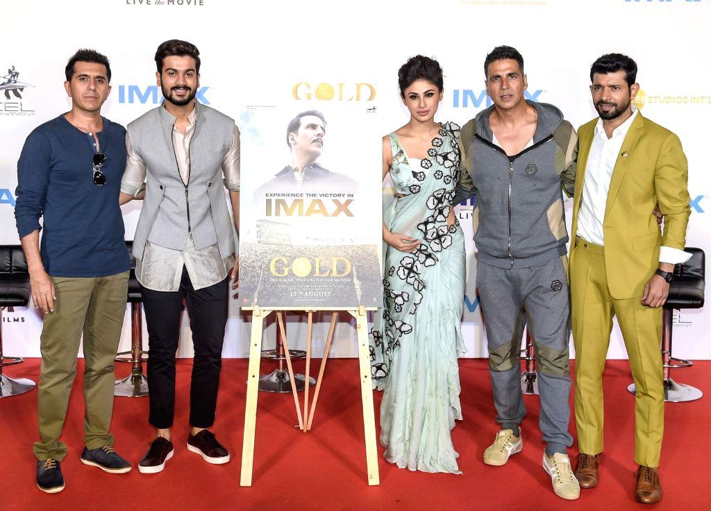 "Producer Ritesh Sidhwani, actors Akshay Kumar, Mouni Roy, Vineet Kumar Singh and Sunny Kaushal at the IMAX trailer and poster launch of their upcoming film ""Gold"" in Mumbai on ... - Akshay Kumar, Mouni Roy, Vineet Kumar Singh and Sunny Kaushal"