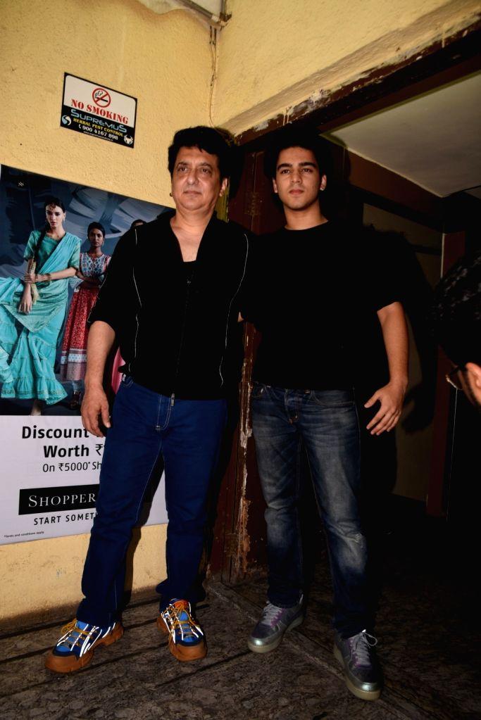 """Producer Sajid Nadiadwala with his son Subhan Nadiadwala at the screening of his upcoming film """"Kalank"""", in Mumbai on April 14, 2019."""