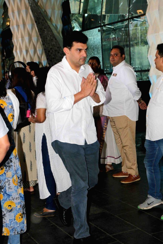 Producer Siddharth Roy Kapur arrives at a prayer meet organised for late producer Raj Kumar Barjatya in Mumbai, on Feb 23, 2019. - Siddharth Roy Kapur and Kumar Barjatya