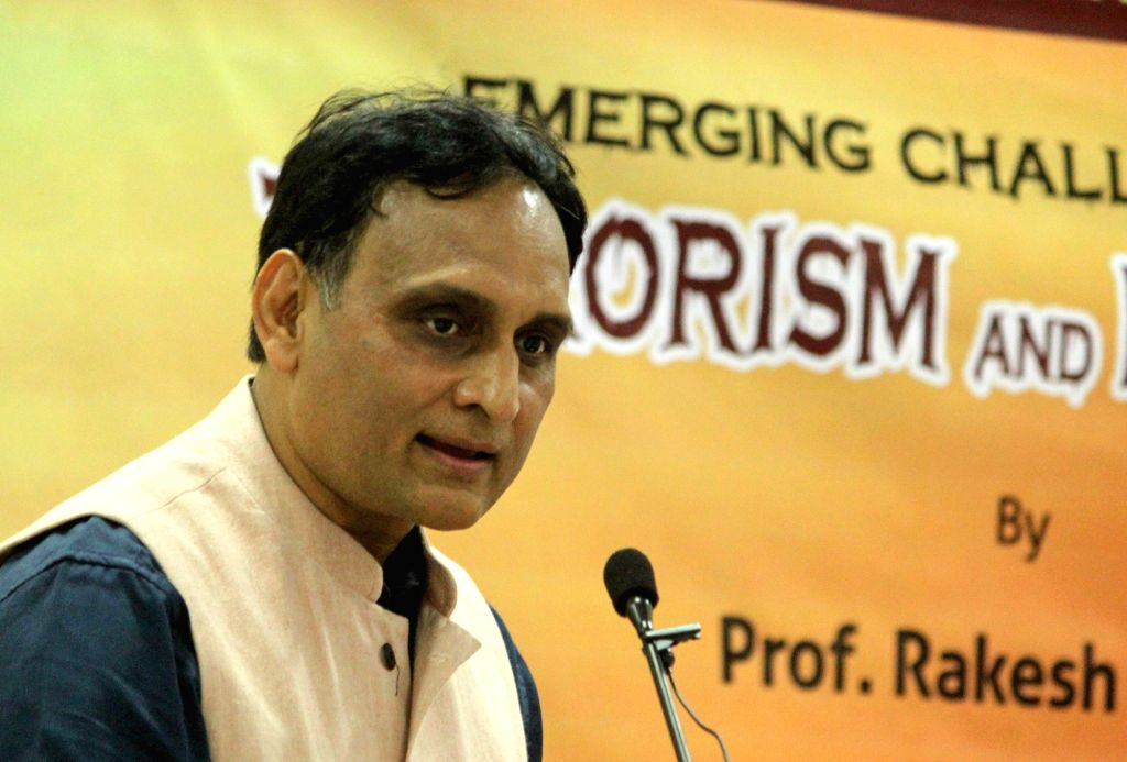 "Prof Rakesh Sinha addresses during a discussion programme on Emerging Challenges of ""Terrorism and Extremism"" in Bengaluru on Aug. 6, 2016. - Rakesh Sinha"