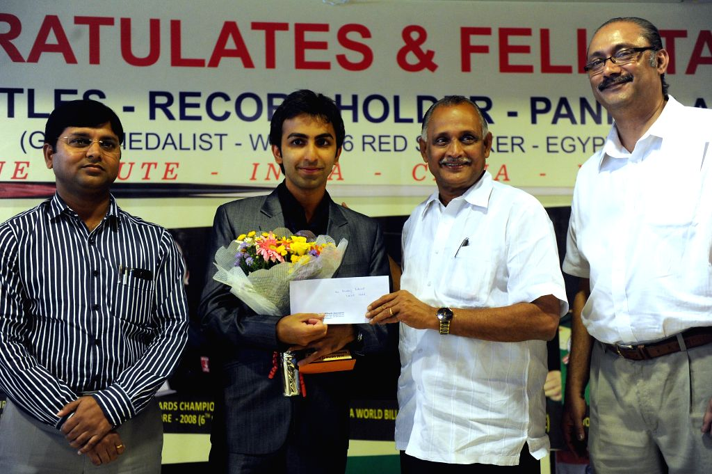 Professional billiards and snooker player Pankaj Advani being felicitated by Karnataka Minister for Youth Services K Abhay Chandra Jain in Bangalore on July 4, 2014.