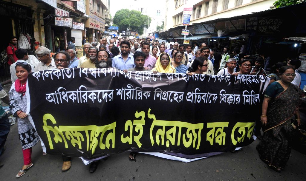 Professor and teaching staff protest against TMC students agitation at Calcutta University in Kolkata on July 2, 2015.