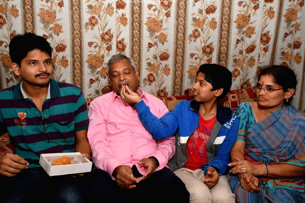Professor Balaram Kishan, who was among the two faculty members held captive in Libya for over a year celebrates with his family members after being rescued in Hyderabad on Sept 24, 2016.