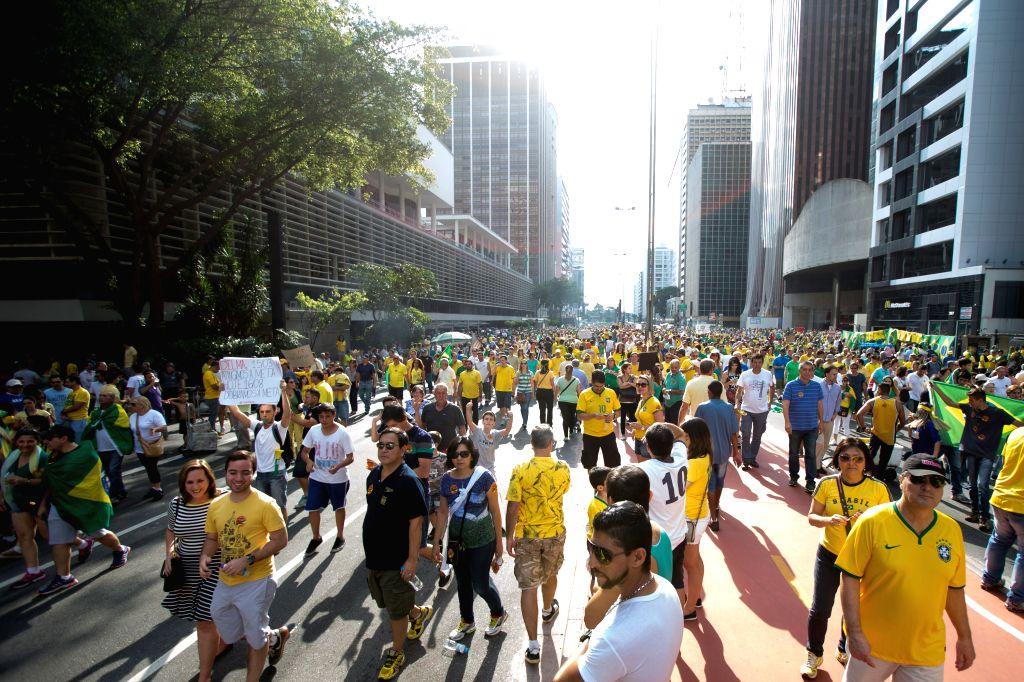 Protester take part in an anti-government demonstration in Sao Paulo, Brazil, Aug. 16, 2015. A demonstration took place on the Paulista Avenue in downtown Sao ...