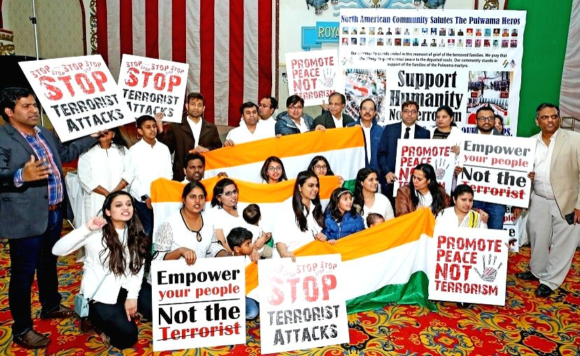 Protesters at a candle-light vigil held in Woodbridge, New Jersey, on Thursday, February 21, 2019, to honour memory of the more than 40 Indian security personnel killed in a terrorist attack by ...
