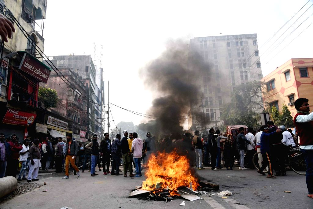 Protesters block streets and disrupt traffic movement as they stage a demonstration against the Citizenship Amendment Act (CAA) 2019, National Register of Citizens (NRC) and National ...