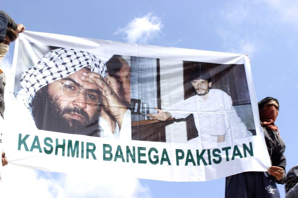"Protesters carry a banner reading ""Kashmir Banega Pakistan"" - Kashmir will become Pakistan - in Srinagar on June 5, 2019."