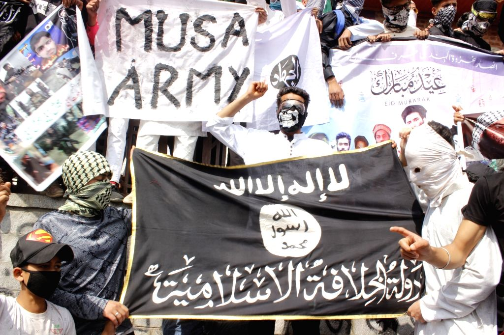 """Protesters carry a banner reading """"Musa Army"""" in Srinagar on June 5, 2019."""