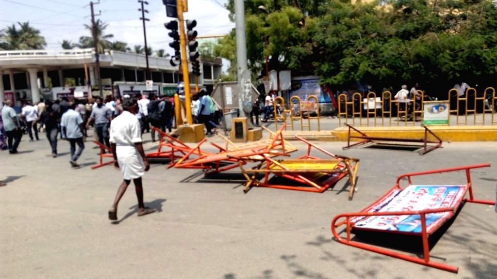 Protesters damage barricades during a demonstration over their demand for the closure of Vedanta's Sterlite copper smelter in Tamil Nadu's Thoothukudi; in Chennai on May 22, 2018.