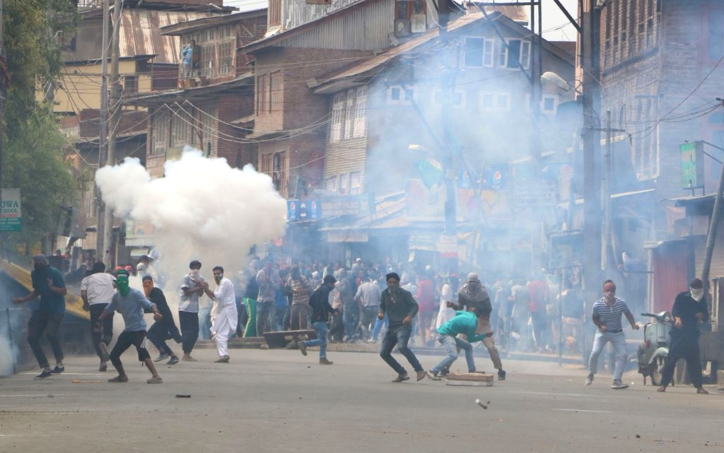 Protesters demonstrating against against proposed Sainik colonies pelt stones on security personnel in Srinagar on June 17, 2016.