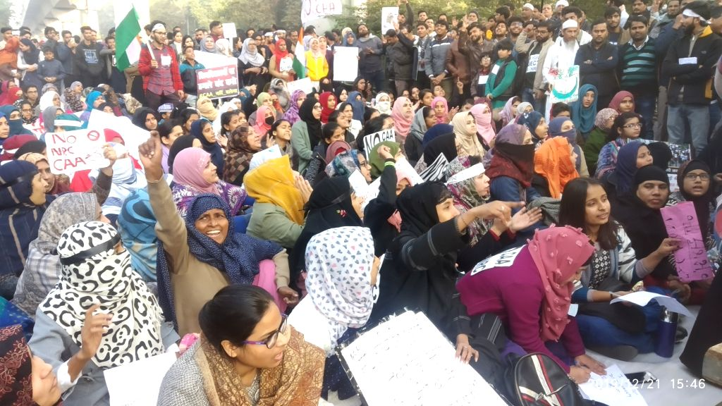 Protesters during a demonstration at Jamia Millia Islamia against against the Citizenship Amendment Act (CAA) 2019 and National Register of Citizens (NRC), in New Delhi.