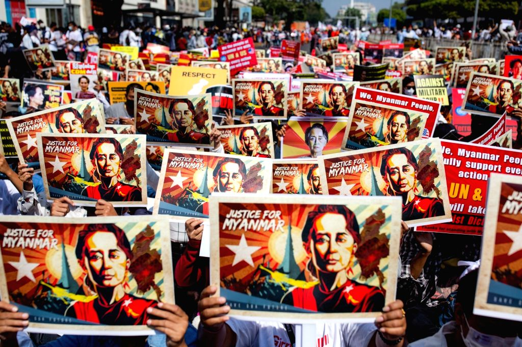 Protesters holds placards and portraits of Myanmar's ousted civilian leader Aung San Suu Kyi during a protest against the military coup. Photo: Aung Kyaw Htet/SOPA Images via ZUMA Wire/dpa/IANS