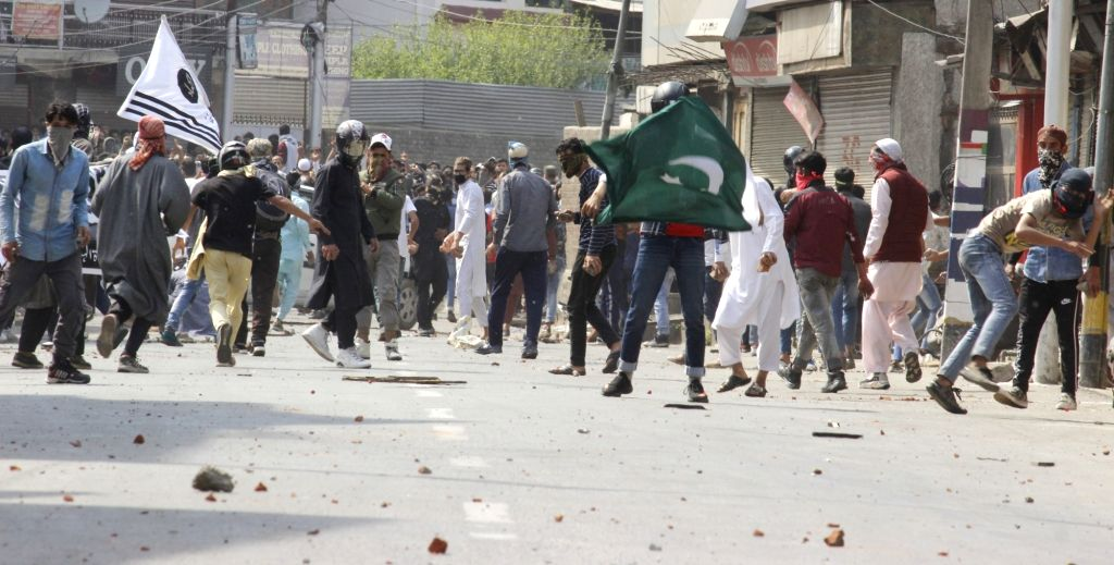 Protesters pelt stones during clashes with security forces at Jamia Masjid in Srinagar, on May 31, 2019.