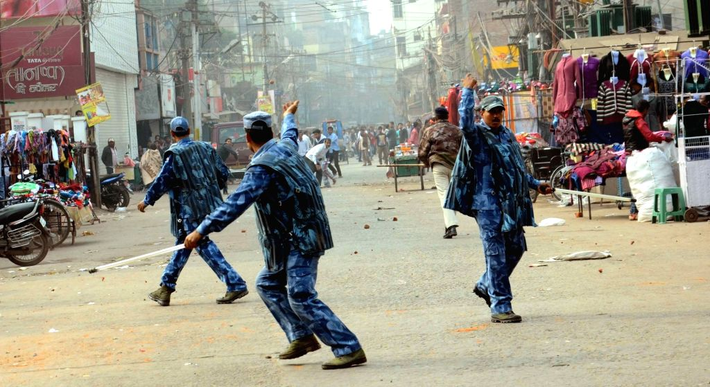 Protesters pelt stones on security personnel at Hathwa Market in Patna, on Dec 9, 2015.