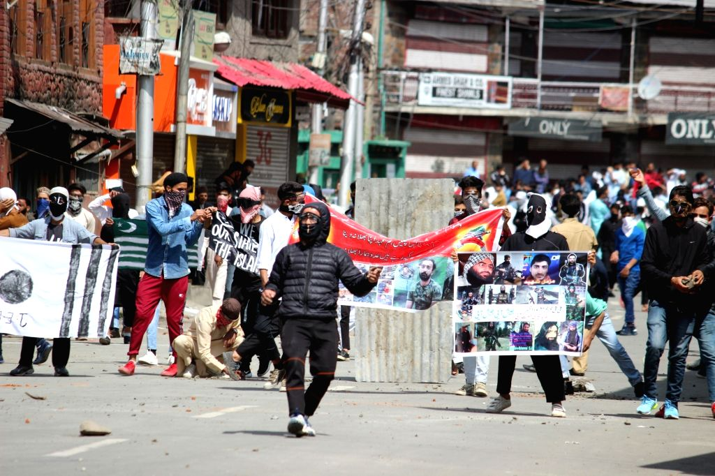 Protesters pelt stones on security personnel i Srinagar on June 5, 2019. Clashes erupted between stone-pelting youths and security forces in Srinagar, Sopore, Anantnag and Kupwara towns in ...