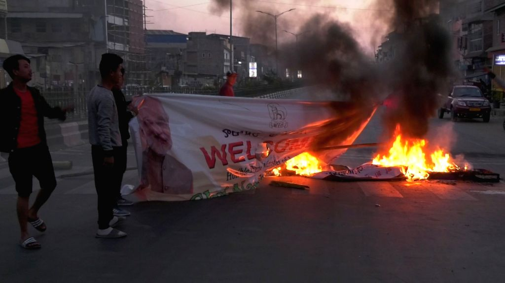 Protesters stage a demonstration demanding withdrawal of the Citizenship (Amendment) Bill defying curfew in Imphal on Feb 12, 2019.