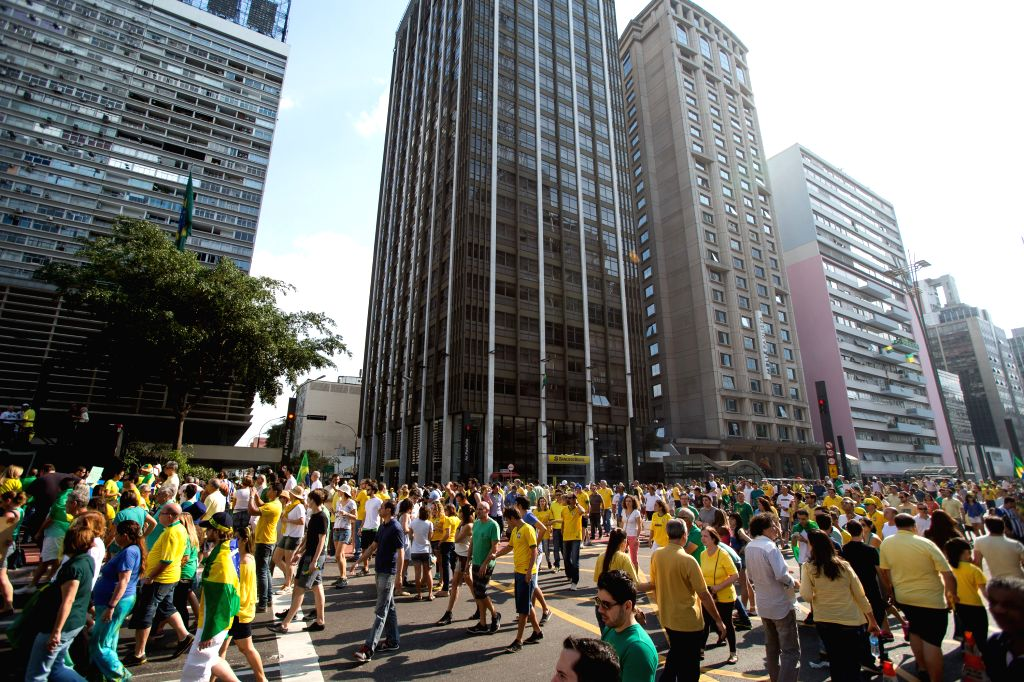 Protesters take part in an anti-government demonstration in Sao Paulo, Brazil, Aug. 16, 2015. A demonstration took place on the Paulista Avenue in downtown Sao ...