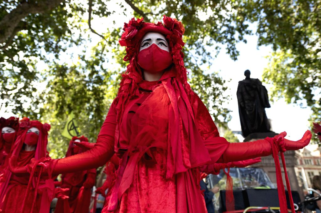 Protesters take part in an Extinction Rebellion demonstration in London, Britain, on Sept. 1, 2020. According to the plan of environmental activists group Extinction ...