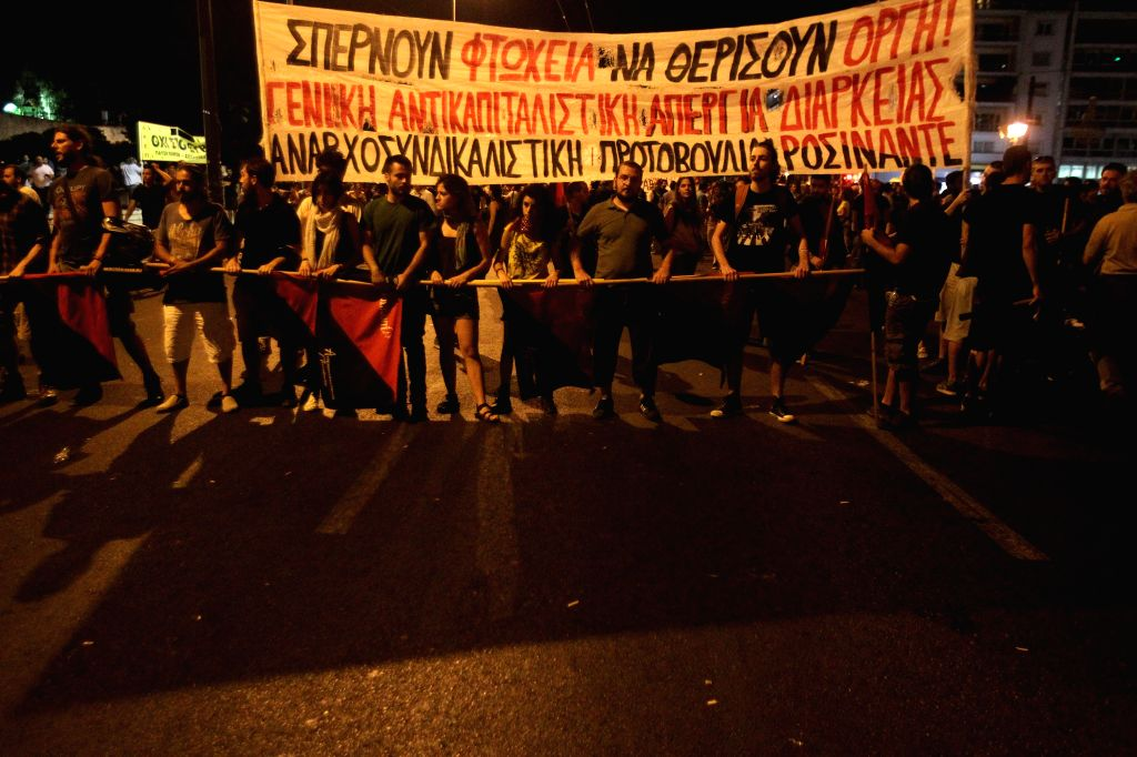 Protestors attend anti-bailout rally in Athens, Greece, July 22, 2015. Greek Parliament is scheduled to vote on early July 23 on an omnibus bill containing the ...