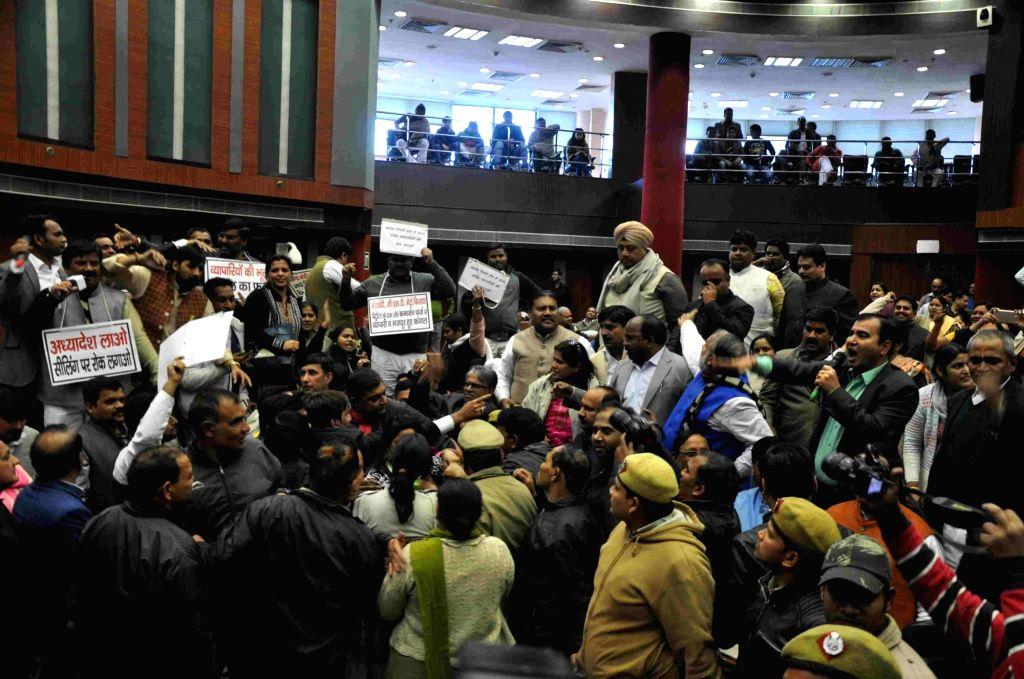 Protestors create ruckus during MCD Council general meeting over sealing drive in New Delhi on Jan 27, 2018.
