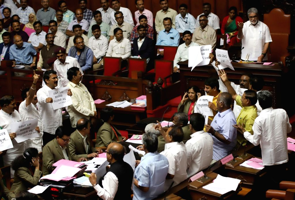 Protests by BJP legislators on Wednesday against an attack by JD-S workers on the house of one of its MLAs in Hassan forced Assembly Speaker K.R. Ramesh Kumar to adjourn the House. (Photo: IANS) - K. and R. Ramesh Kumar