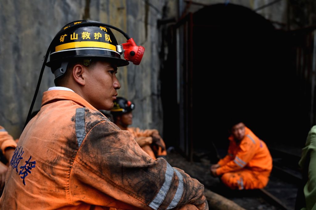 PU'A rescuer works at the site of a coal mine accident in Pu'an County, southwest China's Guizhou Province, Aug. 12, 2015. Ten people were killed and three are missing ...